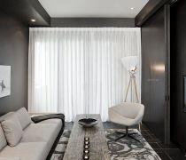 简约时尚客厅有隐形门的电视背景墙装修图